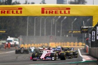 Sergio Perez, Racing Point RP19, leads Daniel Ricciardo, Renault R.S.19, and Nico Hulkenberg, Renault R.S. 19