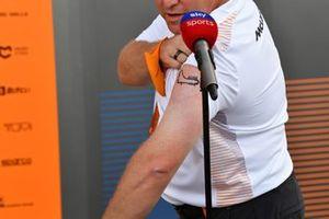 Zak Brown, CEO, McLaren Racing, shows off his new Monza tattoo
