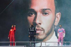 Lewis Hamilton, Mercedes-AMG F1, on the podium after winning the race, to take his 7th World Championship title, with Sergio Perez, Racing Point, 2nd position, and Sebastian Vettel, Ferrari, 3rd position