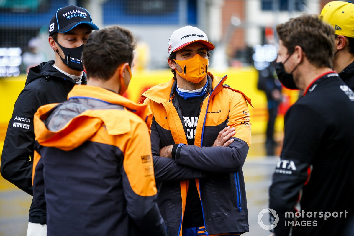 George Russell, Williams Racing, Carlos Sainz Jr., McLaren, and Romain Grosjean, Haas F1, on the grid