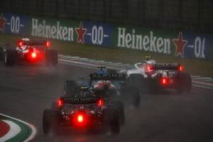 Yuki Tsunoda, AlphaTauri AT02, Mick Schumacher, Haas VF-21, Fernando Alonso, Alpine A521, and Sebastian Vettel, Aston Martin AMR21