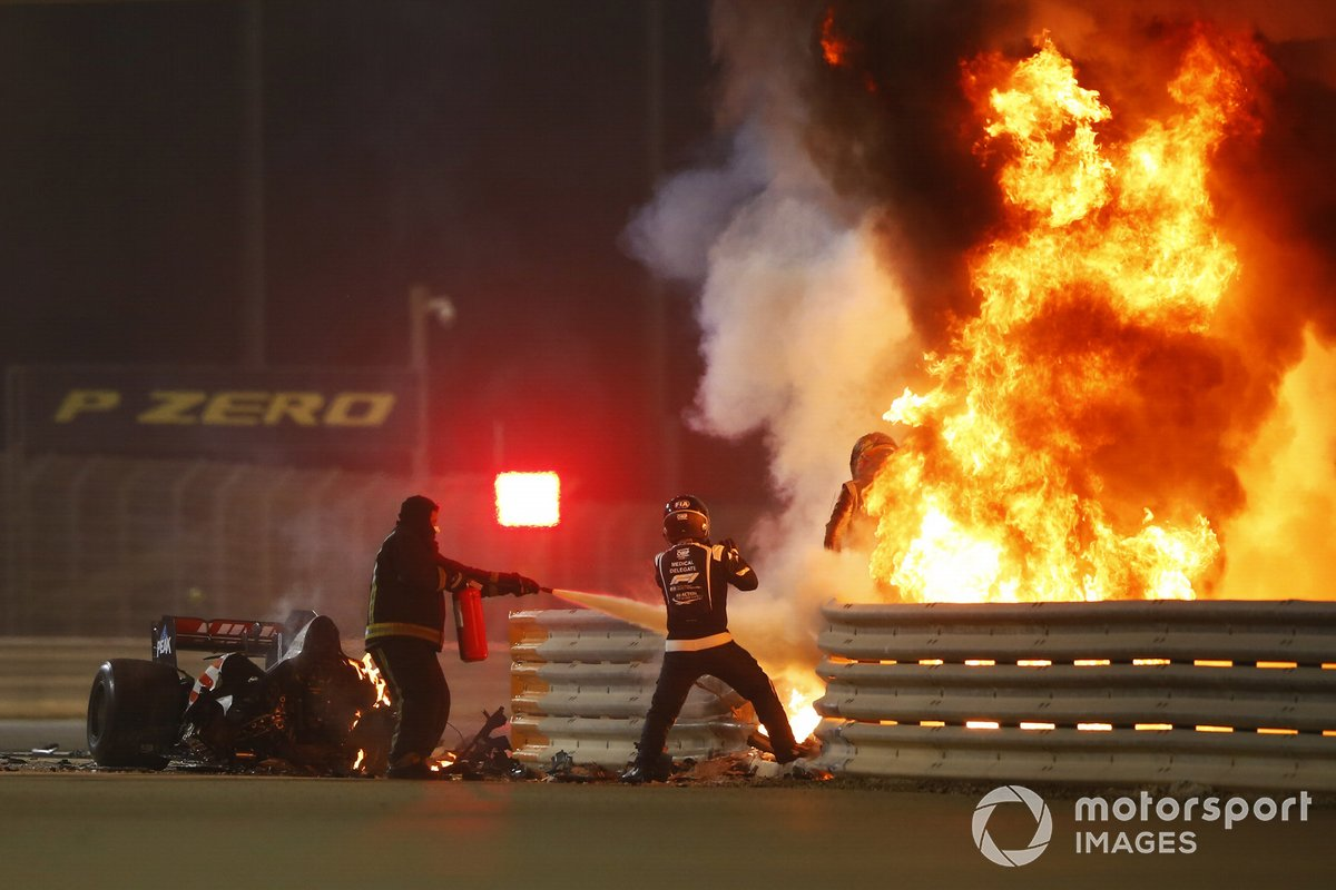 Romain Grosjean, Haas F1, emerges from flames after a horrific crash on the opening lap of the Bahrain Grand Prix, Marshals attend the accident