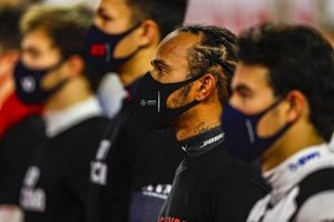 Lewis Hamilton, Mercedes-AMG F1, stands with the other drivers