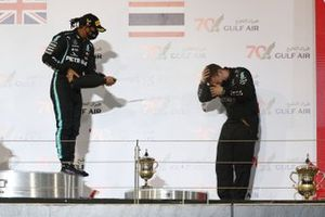 Lewis Hamilton, Mercedes-AMG F1, 1st position, and the Mercedes trophy delegate celebrate on the podium