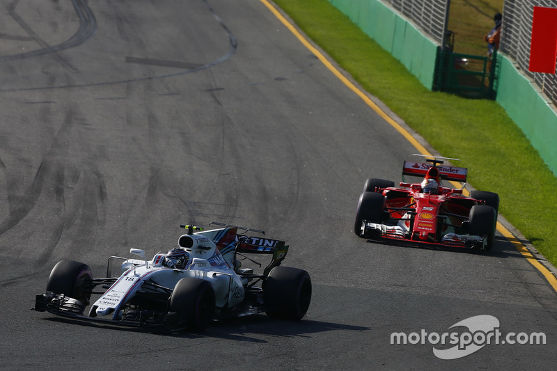 Lance Stroll, Williams FW40, leads Sebastian Vettel, Ferrari SF70H