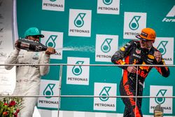Lewis Hamilton, Mercedes AMG F1 and race winner Max Verstappen, Red Bull Racing celebrate on the pod