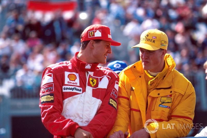 Michael Schumacher, Ferrari F310B with brother Ralf Schumacher, Jordan 197