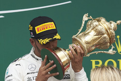 Race winner Lewis Hamilton, Mercedes AMG F1, kisses the trophy on the podium
