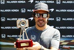 Fernando Alonso, McLaren, collects an award