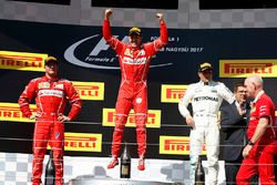 Podium: race winner Sebastian Vettel, Ferrari, second place Kimi Raikkonen, Ferrari, third place Va