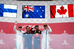 Daniel Ricciardo, Red Bull Racing, celebrates victory on the podium, Valtteri Bottas, Mercedes AMG F