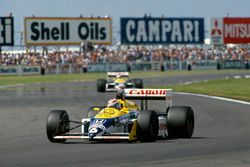 Nelson Piquet, Williams FW11B, leads Nigel Mansell, Williams FW11B