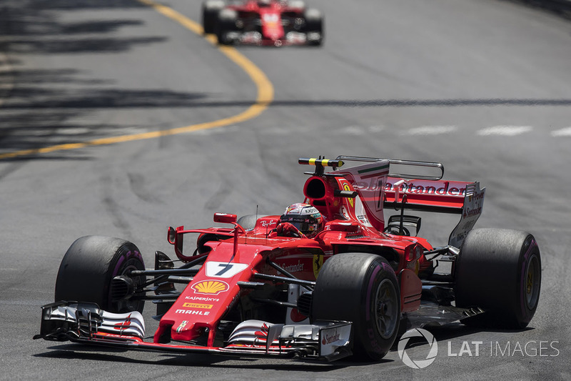 Kimi Raikkonen, Ferrari SF70-H leads Sebastian Vettel, Ferrari SF70-H