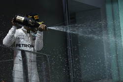 Race winner Lewis Hamilton, Mercedes AMG F1 celebrates on the podium, the champagne