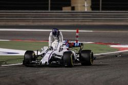 Lance Stroll, Williams FW40, climbs out of his damaged car after a collision with Carlos Sainz Jr.,