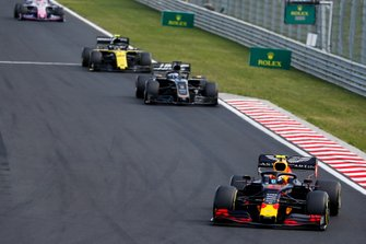 Pierre Gasly, Red Bull Racing RB15, leads Romain Grosjean, Haas F1 Team VF-19, and Nico Hulkenberg, Renault F1 Team R.S. 19