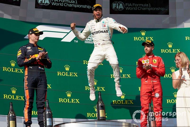 Max Verstappen, Red Bull Racing, 2nd position, Lewis Hamilton, Mercedes AMG F1, 1st position, and Sebastian Vettel, Ferrari, 3rd position, celebrate on the podium