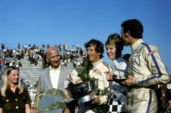 Race winner Jochen Rindt, Lotus with Miss United States GP and Piers Courage, Brabham