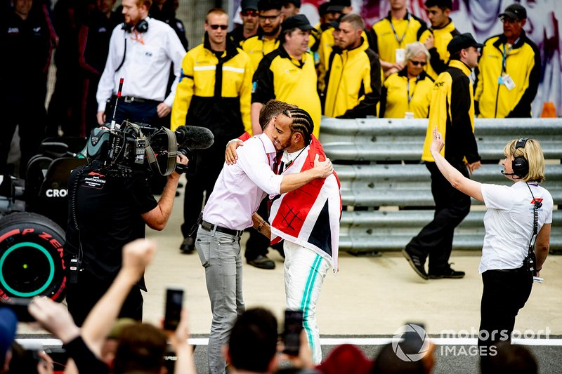 Lewis Hamilton, Mercedes AMG F1, 1st position, is congratulated by Jenson Button, Sky Sports F1