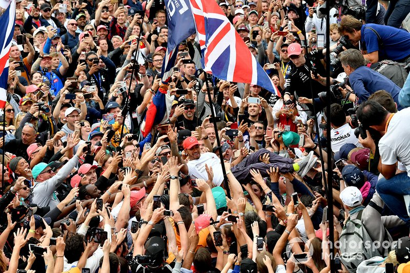 Lewis Hamilton, Mercedes AMG F1, 1st position, celebrates by crowd surfing over fans