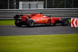 Sebastian Vettel, Ferrari SF90, takes to an escape road