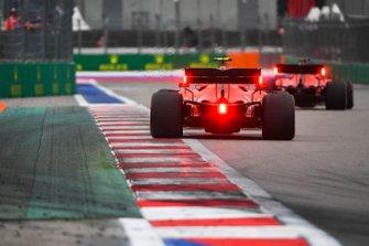 Charles Leclerc, Ferrari SF90, follows Sebastian Vettel, Ferrari SF90