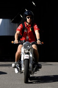 Sebastian Vettel, Ferrari, on a motorcycle