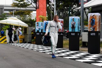 Valtteri Bottas, Mercedes AMG F1 arrive back into the paddock