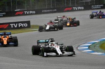 Lewis Hamilton, Mercedes AMG F1 W10, leads Carlos Sainz Jr., McLaren MCL34, and Kimi Raikkonen, Alfa Romeo Racing C38