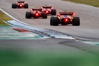 Pierre Gasly, Red Bull Racing RB15, leads Lando Norris, McLaren MCL34