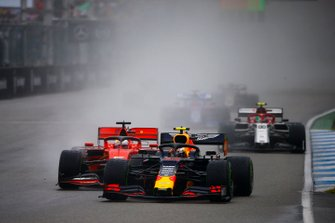 Pierre Gasly, Red Bull Racing RB15, leads Sebastian Vettel, Ferrari SF90, and Antonio Giovinazzi, Alfa Romeo Racing C38