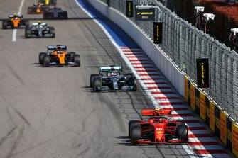 Charles Leclerc, Ferrari SF90, leads Lewis Hamilton, Mercedes AMG F1 W10, Carlos Sainz Jr., McLaren MCL34, Valtteri Bottas, Mercedes AMG W10, and Lando Norris, McLaren MCL34