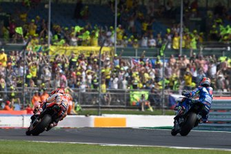 Alex Rins, Team Suzuki MotoGP, wins, Marc Marquez, Repsol Honda Team` with hand on his head
