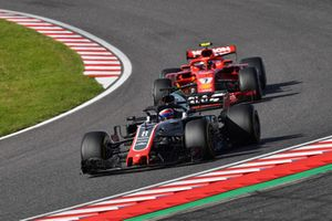 Romain Grosjean, Haas F1 Team VF-18 devant Kimi Raikkonen, Ferrari SF71H