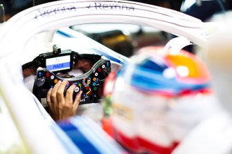 Robert Kubica, Williams Martini Racing, adjusts his steering wheel