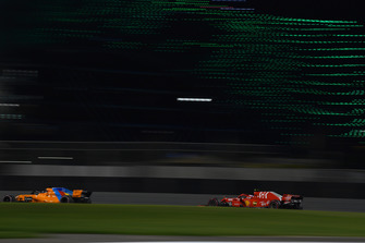 Fernando Alonso, McLaren MCL33 and Kimi Raikkonen, Ferrari SF71H