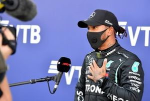 Lewis Hamilton, Mercedes-AMG F1, is interviewed after securing pole