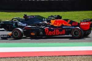 Lewis Hamilton, Mercedes F1 W11, passes Alex Albon, Red Bull Racing RB16