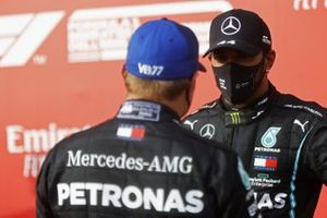 Valtteri Bottas, Mercedes-AMG F1, 2nd position, talks with Lewis Hamilton, Mercedes-AMG F1, 1st position