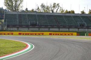 Sponsor signage and a trackside grandstand
