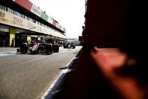 Sebastian Vettel, Ferrari SF1000, Charles Leclerc, Ferrari SF1000, in the pit lane