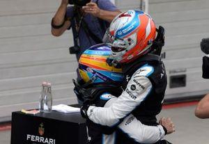 Fernando Alonso, Alpine F1, celebrates with Esteban Ocon, Alpine F1, 1st position, in Parc Ferme