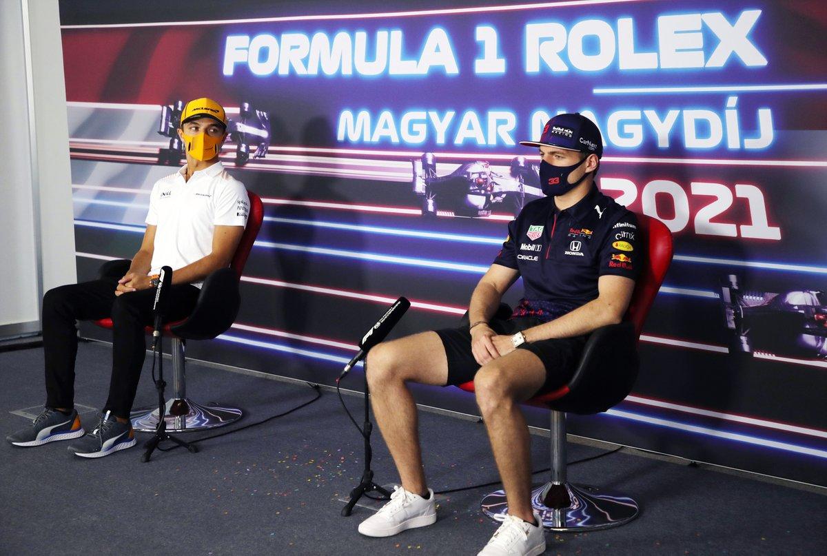 Lando Norris, McLaren. Max Verstappen, Red Bull Racing