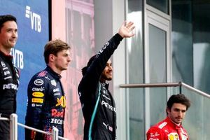 Max Verstappen, Red Bull Racing, 2nd position, Lewis Hamilton, Mercedes, 1st position, and Carlos Sainz Jr., Ferrari, 3rd position, on the podium