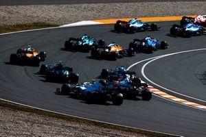 Antonio Giovinazzi, Alfa Romeo Racing C41, Esteban Ocon, Alpine A521, Fernando Alonso, Alpine A521, George Russell, Williams FW43B, Daniel Ricciardo, McLaren MCL35M, and Lance Stroll, Aston Martin AMR21, on the opening lap