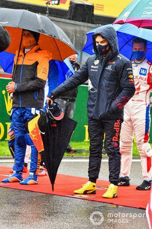 Lando Norris, McLaren, and Sergio Perez, Red Bull Racing, on the grid