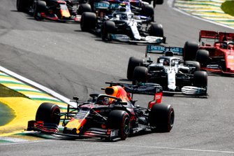 Max Verstappen, Red Bull Racing RB15, leads Lewis Hamilton, Mercedes AMG F1 W10, Charles Leclerc, Ferrari SF90, and the rest of the field through the first corners