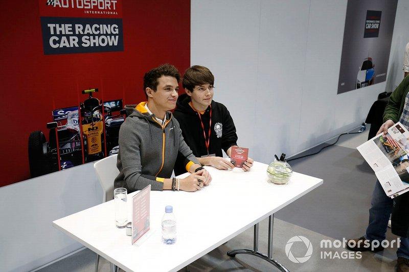 Lando Norris, McLaren poses for a photograph with a fan