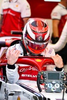 Kimi Raikkonen, Alfa Romeo Racing, drops in to his seat