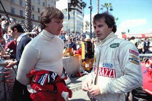Didier Pironi and Gilles Villeneuve talk in the Ferrari pit